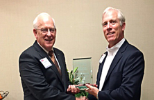 Craig Becker (left), President of the Tennessee Hospital Association presents HMC CEO Nick Lewis with the 2016 THA Small or Rural Hospital Leadership Award in recognition of his service to rural healthcare in Tennessee.